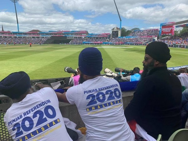 Khalistan supporters sit among the crowd during an ICC cricket world cup match