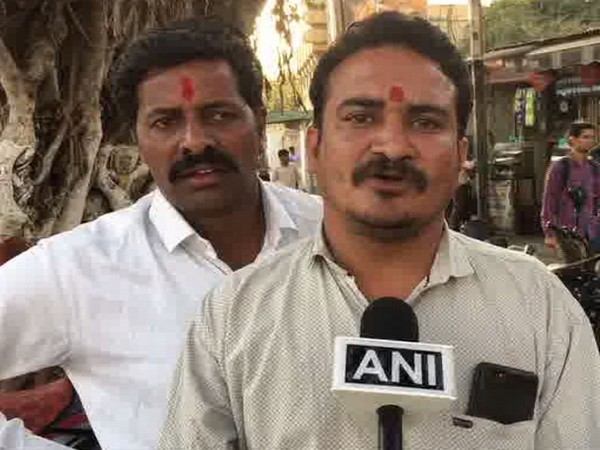 Madhya Pradesh Congress Secretary Vivek Khandelwal, who accepted of pasting posters on train