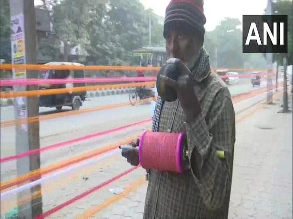 A man selling cotton kite-flying threads in Punjab's Amritsar. (Photo/ANI)