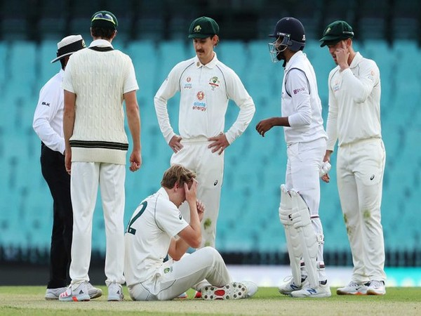 Australia A all-rounder Cameron Green sits on the ground after being hit by Bumrah's drive (Photo/ cricket.com.au Twitter)