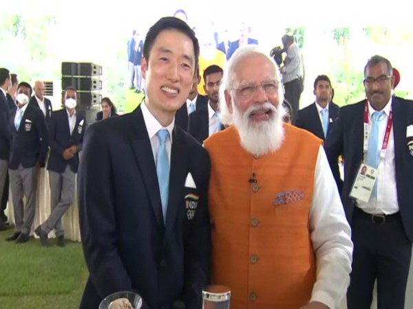 PV Sindhu's coach with Prime Minister Narendra Modi