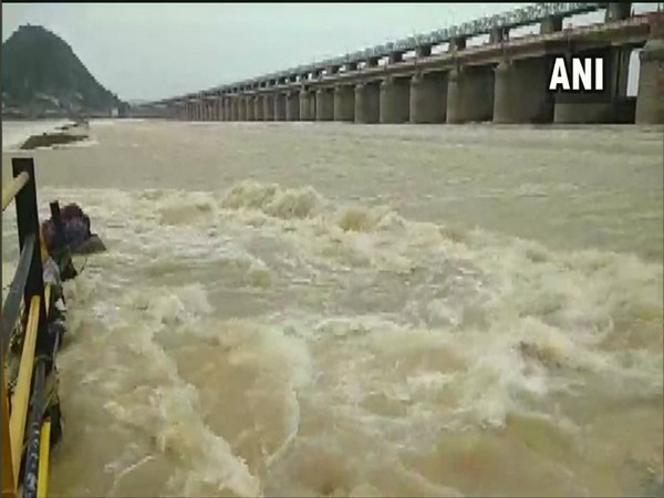 70 crest gates of Prakasam barrage were lifted to discharge excess water on Wednesday. Photo/ANI