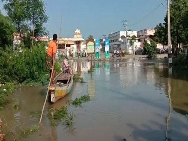 Villagers of Gani Atkuru using boats to travel across the village after the region was hit with heavy rainfall. Photo/ANI