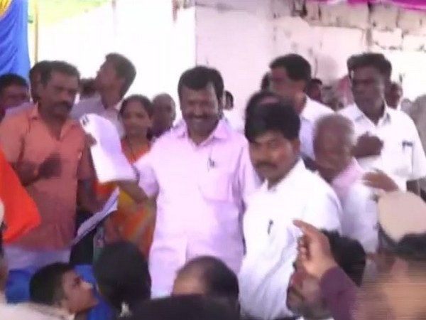 BJP MP Narayanaswamy (in pink shirt) during the event on Monday. Photo/ANI