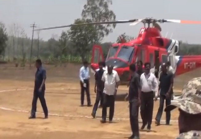 A flying squad of the Election Commission conducting search inside helicopter of Karnataka chief minister HD Kumaraswamy in Shivamogga on Wednesday Photo/ANI