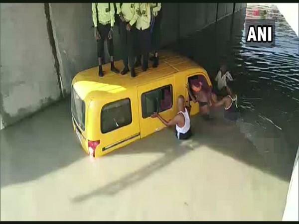 School van stuck in water logged area in Kushinagar on Monday (Photo/ANI)