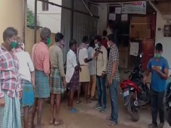 People were seen in large ques in front of liquor shops in Chittoor district on Sunday. (Photo/ANI)
