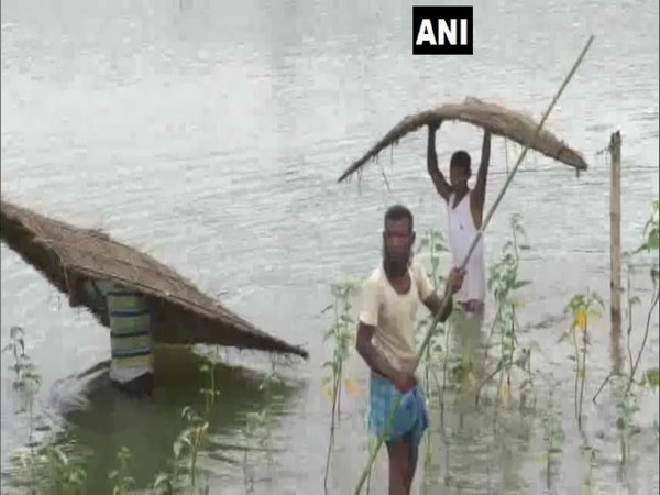 People affected due to flood at Lakhimpur in Assam on Friday