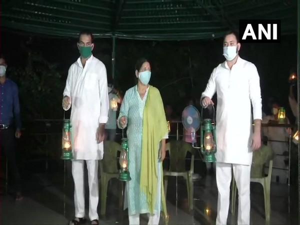 RJD leaders Tejashwi Yadav, Rabri Devi and Tej Pratap Yadav. (Photo/ANI)