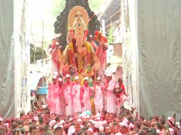 Devotees marching with Ganpati's idol in the city on Thursday. Photo/ANI
