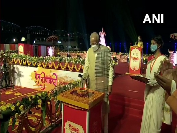 Prime Minister Narendra Modi lighting a lamp to launch Dev Deepwali Mahtosav in Varanasi on Sunday. (Photo/ANI)