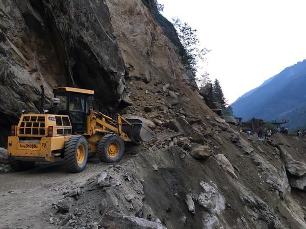 Debris and boulders lying on the route after landslide.