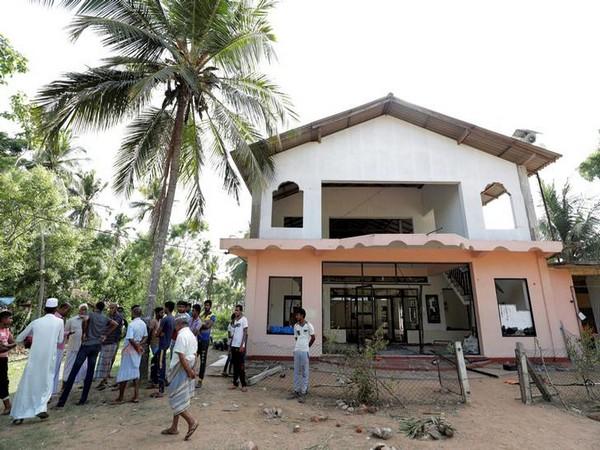 Muslim men gather outside the Abbraar Masjid mosque after a mob attack in Kiniyama, Sri Lanka on Sunday (photo courtesy: Reuters)