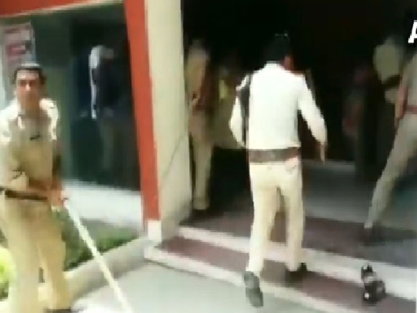 Uttar Pradesh police officals beat transgenders with lathi in Meerut on Monday. Photo/ANI
