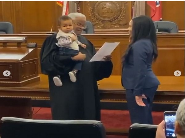 Mom takes oath to become lawyer while judge holds her baby, video goes viral