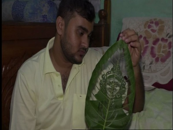 Subham Saha, the leaf artist shocased his art piece to ANI in Agartala on Friday [Photo/ANI]