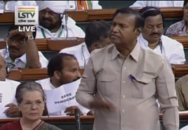 Congress MPs showing Save Democracy slogans in Lok Sabha in New