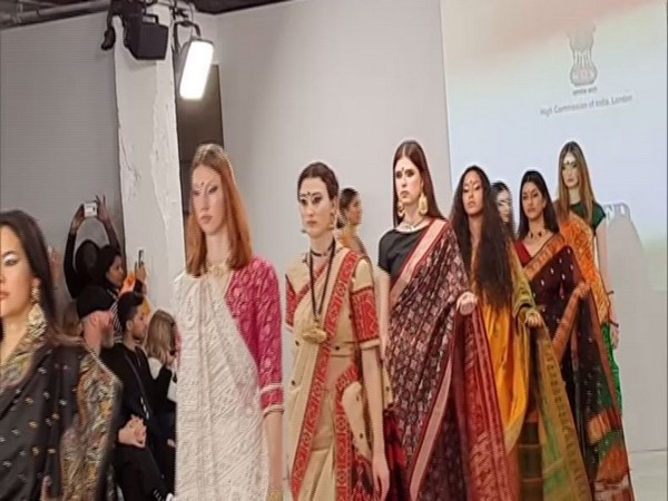 The most globally recognized Indian fashion item took centre stage on India Day - the Sari (Picture Courtesy: ANI)