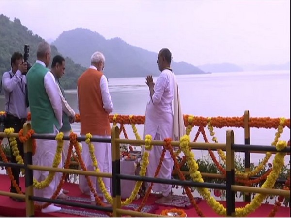 PM Modi performs Narmada poojan at Kevadia Dam on Tuesday. [Photo/ANI]