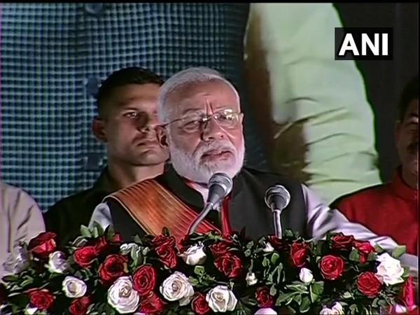 Prime Minister Narendra Modi addressing BJP workers Palam airport on Saturday. (Photo/ANI)