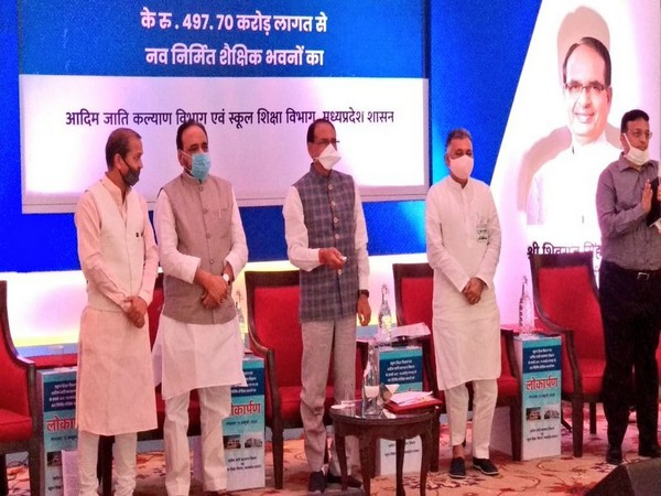 Madhya Pradesh Chief Minister Shivraj Singh Chauhan (in middle) during the event in Bhopal on Tuesday. (Photo/ANI)