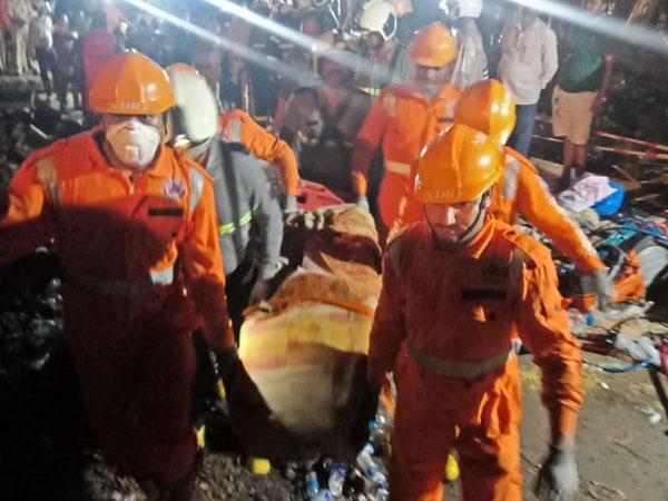 An NDRF team carrying away a body in Ratnagiri, Maharashtra. (Photo/ANI)
