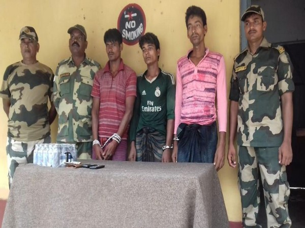 Border Security Force with three Bangladeshi national who were apprehended on Thursday Morning. (Photo/ANI)