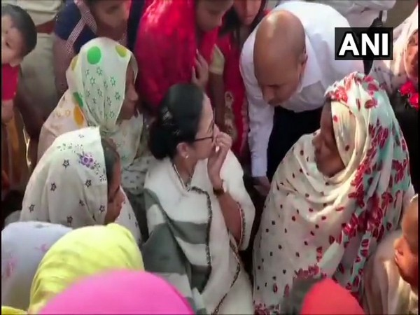 Chief Minister Mamata Banerjee meeting family members of the labourers who were killed by terrorists in Kulgam, Jammu and Kashmir last month.