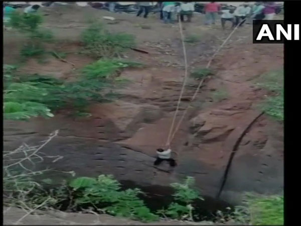 Locals help in rescuing a man who fell into a well in Mucharla Nagaram area