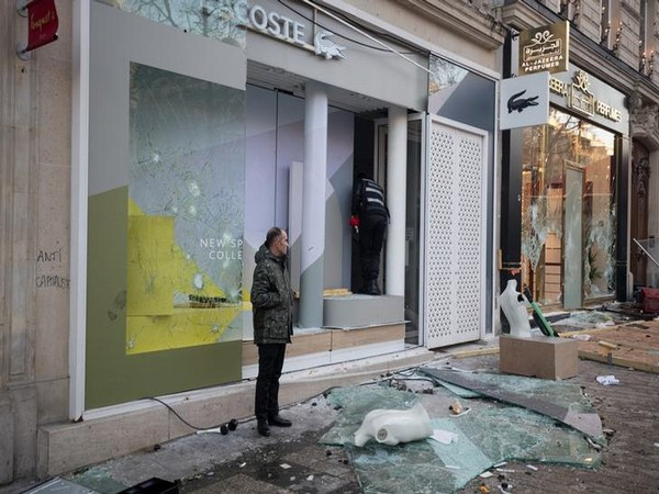 A damaged shop in Champs Elysees following violent yellow vest protests in Paris, France on March 16