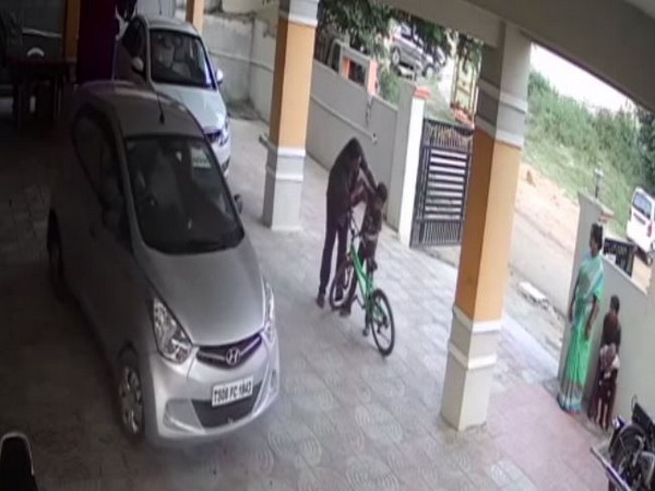 The accused thrashing the minor at an apartment parking lot in Hyderabad on November 8