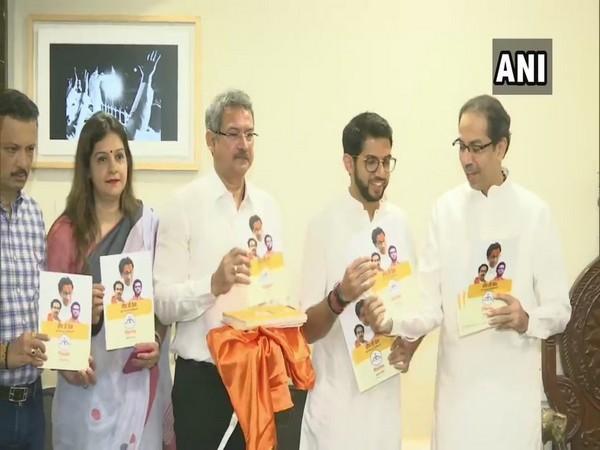 Shiv Sena chief Uddhav Thackeray and Aditya Thackeray at manifesto release in Mumbai on Saturday