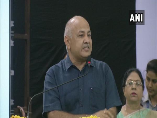 Deputy Chief Minister Manish Sisodia addressing students at Thyagraj Stadium in Delhi on Saturday.
