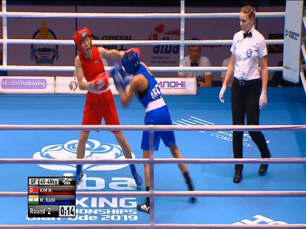 Manju Rani (Blue) punching her opponent Kim Hyang Mi (Red) during the quarterfinal bout. (Photo/Boxing Federation Twitter)