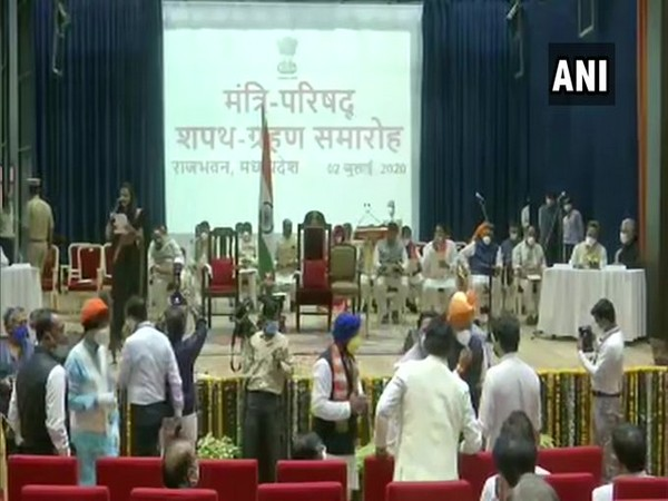 28 Ministers were administered the oath of office and secrecy by Governor Anandiben Patel at Raj Bhawan in Bhopal on Thursday. [Photo/ANI]