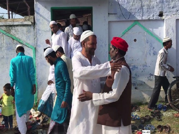 People wishing each other after offering Namaz at a mosque in Ayodhya, Uttar Pradesh on August 12. Photo/ANI
