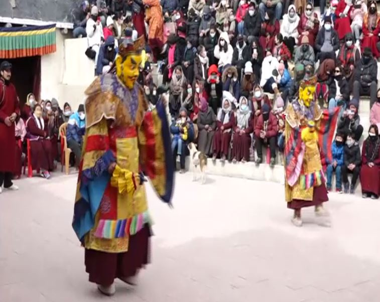 TRS Party workers wearing masks with KCR's picture on them on the occasion of party formation day in Hyderabad on Monday.  Photo/ANI