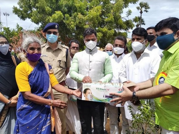 Veera Raghava Rao, District Collector, Ramanathapuram receiving NT masks by Saleem, Trustee, Green Rameswaram.
