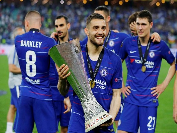 Chelsea midfielder Mateo Kovacic with Europa League trophy