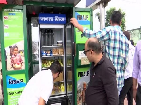 People utilising the public fridge installed in Dehradun market in Uttarakhand. Photo/ANI