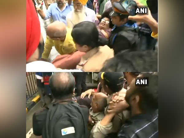 An elderly woman and man fell ill while protesting along with PMC bank depositors in Mumbai on Saturday. Photo/ANI