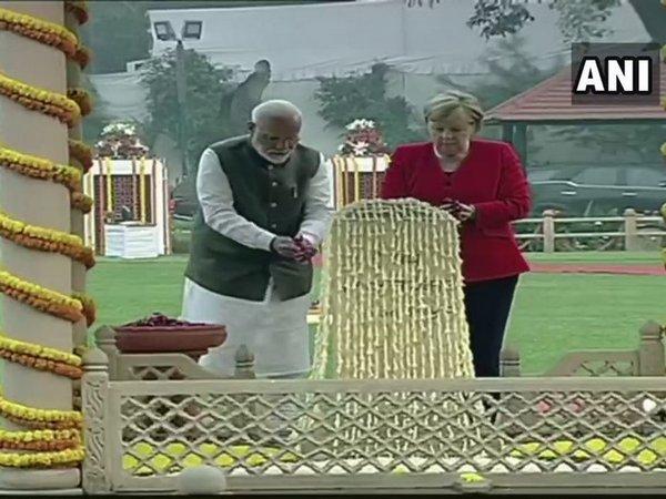 German Chancellor Merkel, PM Modi pay homage at Gandhi Smriti