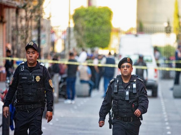 Police officers at the crime scene in Mexico city where four people were killed on Saturday