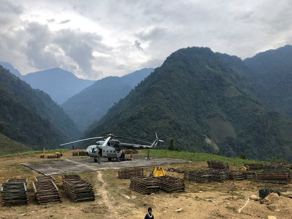 IAF's Mi-17 helicopter airlifts material for bridge construction over Kume river in Arunachal.