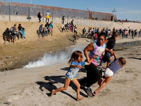 Migrants escaping tear gas at the US-Mexico border last year. (File photo)