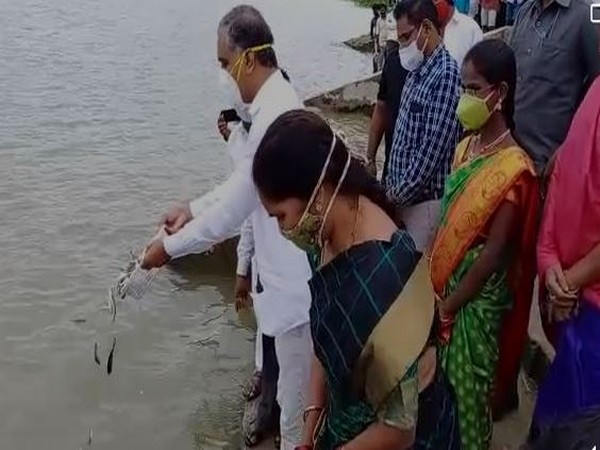 The minister released 1.76 crore fish into the village pond, as part of the programme. (Photo: ANI)
