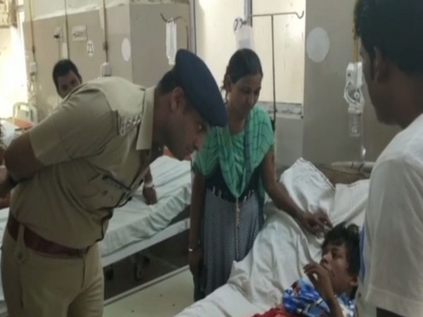 CO Swaran Singh with the victim at the hospital in Lucknow on Thursday. Photo/ANI