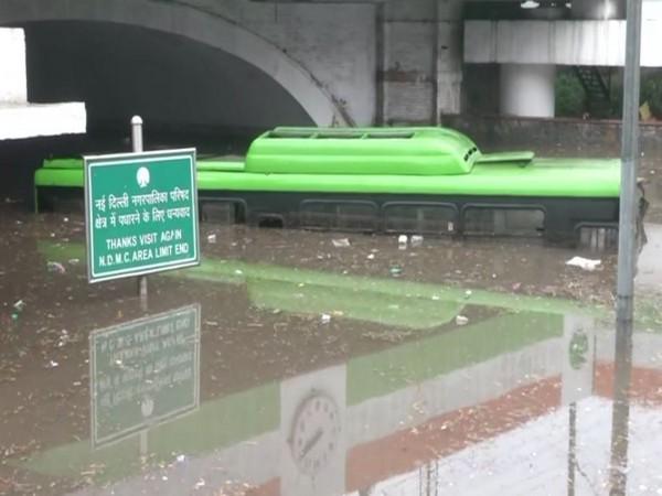 A bus stuck on the waterlogged road under Delhi's Minto Bridge. [Photo/ANI]
