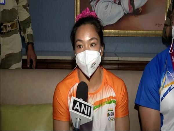 Weightlifter Mirabai Chanu after returning to India