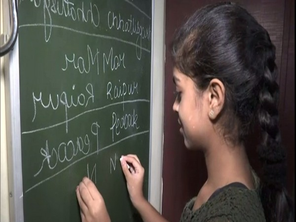 Teenage girl Kavya Chavda in Raipur has perfected a unique skill of mirror writing with one hand, while simultaneously writing in plain script with the other. Photo/ANI